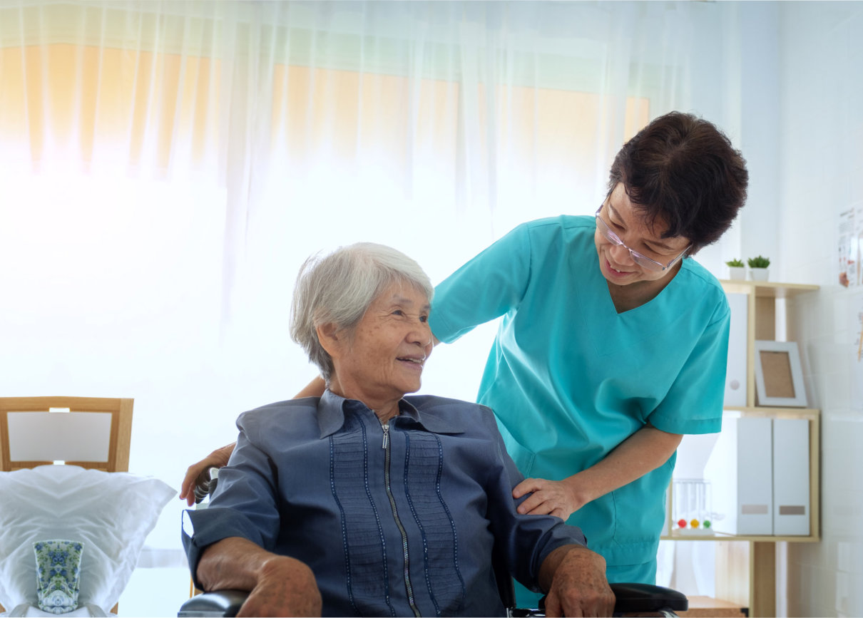 a caregiver taking care of a senior woman
