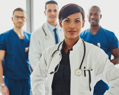 a group of medical staff in their work uniform